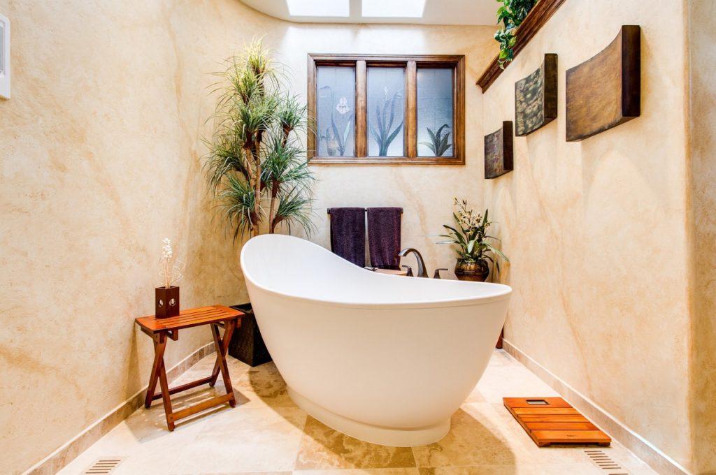 white enamel bathtub in a bright bathroom